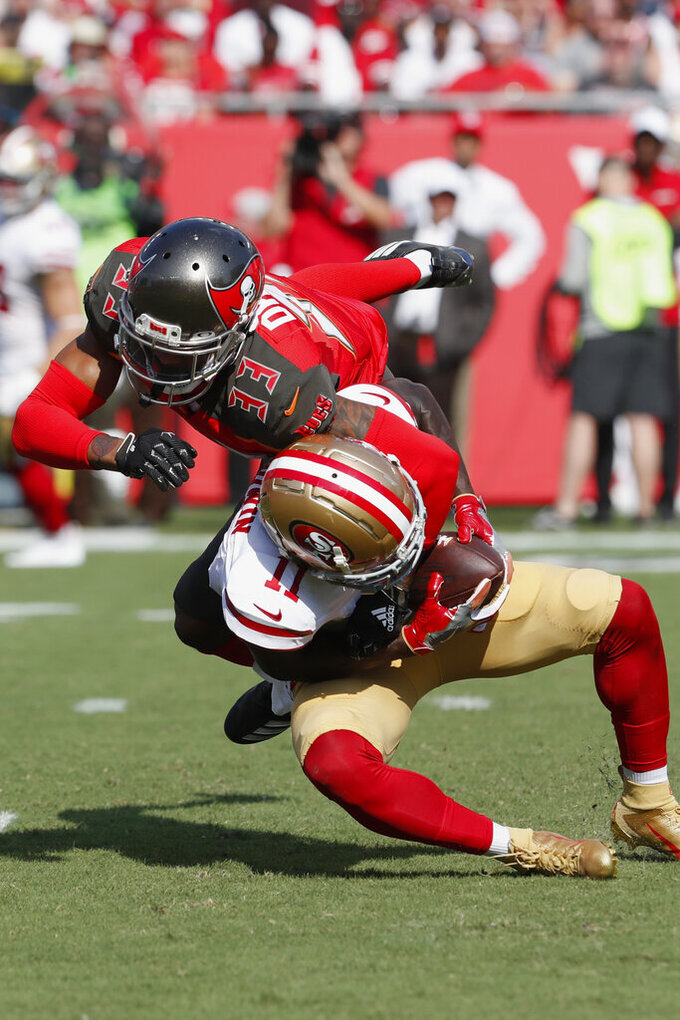 San Francisco 49ers wide receiver Marquise Goodwin (11) makes the catch against Tampa Bay Buccaneers cornerback Carlton Davis (33) during the first half an NFL football game, Sunday, Sept. 8, 2019, in Tampa, Fla. (AP Photo/Mark LoMoglio)