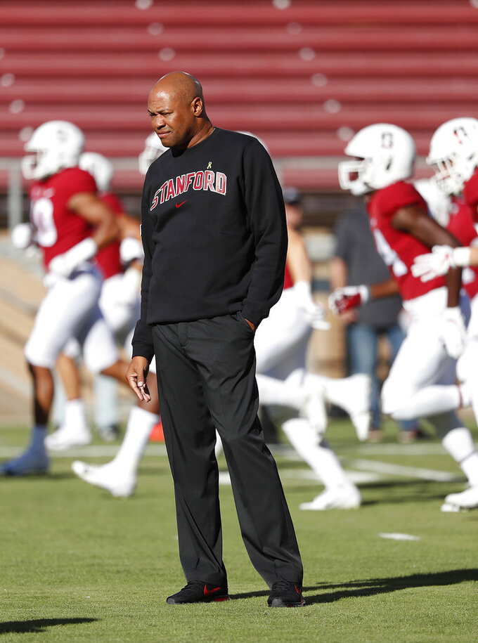 Stanford coach David Shaw watches players warm up for an NCAA college football game against San Diego State on Friday, Aug. 31, 2018, in Stanford, Calif. (AP Photo/Tony Avelar)