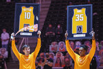 Tennessee forward John Fulkerson (10) and guard Yves Pons (35) are recognized on senior day before an NCAA college basketball game against Florida Sunday, March 7, 2021, in Knoxville, Tenn. (Randy Sartin/Pool Photo via AP)