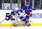 New York Rangers' Chris Kreider (20) checks Buffalo Sabres' Jacob Bryson (78) into the boards during the third period of an NHL hockey game Tuesday, April 27, 2021, in New York. (Bruce Bennett/Pool Photo via AP)