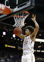 FILE - In this March 7, 2018, file photo, Texas' Jericho Sims dunks during the second half of the team's NCAA college basketball game against Iowa State in the Big 12 men's tournament in Kansas City, Mo. Sims will either deliver on the potential as wide as his broad shoulders, or he will lose out to incoming freshmen Will Baker and Kai Jones. (AP Photo/Charlie Riedel, File)