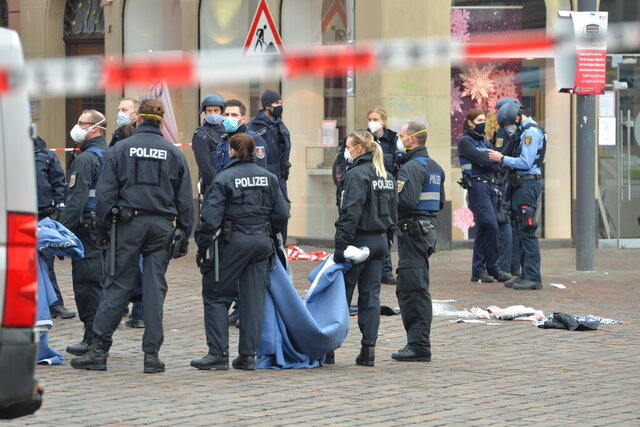 A street is blocked by the police in Trier, Germany, Tuesday, Dec. 1, 2020.  German police say people have been killed and several others injured in the southwestern German city of Trier when a car drove into a pedestrian zone. Trier police tweeted that the driver had been arrested and the vehicle impounded. (Harald Tittel/dpa via AP)