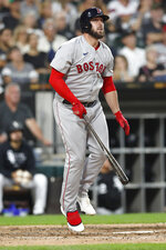 Boston Red Sox's Travis Shaw, right, watches his three-run home run in the third inning against the Chicago White Sox during a baseball game, Saturday, Sept. 11, 2021, in Chicago. (AP Photo/Jeff Haynes)