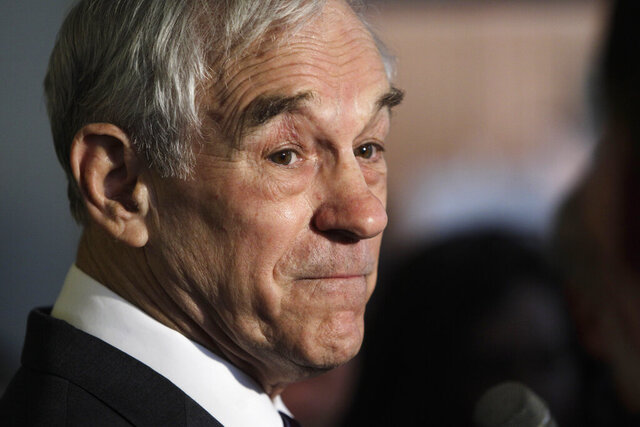 FILE - In this Feb. 27, 2012, file photo Republican presidential candidate Rep. Ron Paul, R-Texas, speaks at the Little Rock Baptist Church in Detroit. Former GOP presidential candidate Paul posted a picture of himself in a hospital Friday, Sept. 25, 2020, but said he was OK after video circulated online of him struggling to speak during an interview. (AP Photo/Carlos Osorio, File)