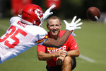 FILE - In this July 29, 2019, file photo, Kansas City Chiefs defensive coordinator Steve Spagnuolo watches a drill during NFL football training camp in St. Joseph, Mo. When the coronavirus pandemic forced everyone indoors — away from their everyday environments — creativity was the key. To working. To keeping in touch. And, for those making their living playing on football fields, to thinking up ways to bond as teammates. (AP Photo/Charlie Riedel)