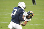 Maryland defensive back Tarheeb Still (12) tackles Penn State wide receiver Parker Washington (3) in the second quarter of an NCAA college football game in State College, Pa., Saturday, Nov. 7, 2020. (AP Photo/Barry Reeger)