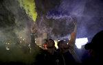 Men set off flares during a