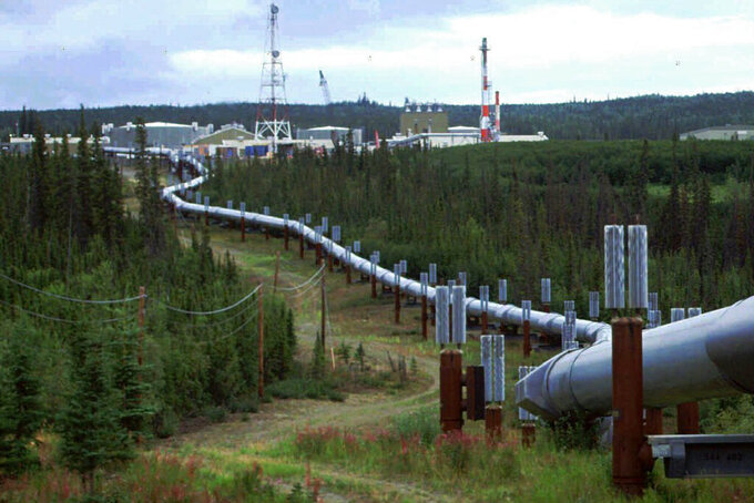 FILE - In this undated file photo the Trans-Alaska pipeline and pump station north of Fairbanks, Alaska is shown. Congressional Democrats are moving to reinstate regulations designed to limit potent greenhouse gas emissions from oil and gas fields. It's part of a broader effort by the Biden administration to combat climate change.(AP Photo/Al Grillo, file)