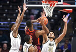 Virginia Tech guard Landers Nolley II (2) shoots as he is fouled by Wake Forest center Olivier Sarr (30) during an NCAA college basketball game Tuesday, Jan. 14, 2020 in Winston-Salem, N.C. (Andrew Dye/Winston-Salem Journal via AP)