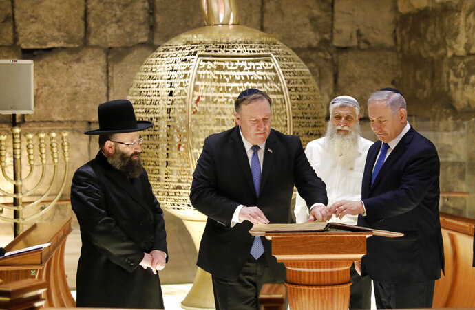 From left, Rabbi of the Western Wall Shmuel Rabinovitch, U.S Secretary of State Mike Pompeo, center, Israeli Prime Minister Benjamin Netanyahu visits the Western Wall tunnels synagogue in Jerusalem's Old City on Thursday, March 21, 2019.  (Abir Sultan/Pool Image via AP)