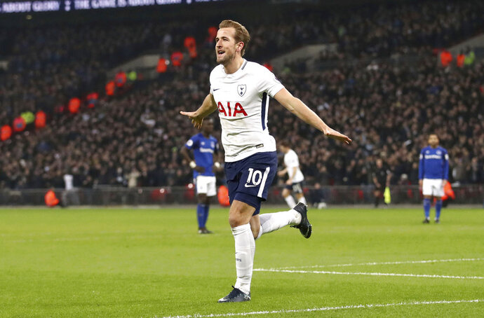 Tottenham Hotspur's Harry Kane celebrates scoring his side's third goal of the game during the English Premier League soccer match Tottenham Hotspur versus Everton at Wembley Stadium, London, Saturday Jan. 13, 2018. (John Walton/PA via AP)