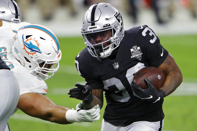 Las Vegas Raiders running back Jalen Richard (30) runs against the Miami Dolphins during the first half of an NFL football game, Saturday, Dec. 26, 2020, in Las Vegas. (AP Photo/Steve Marcus)