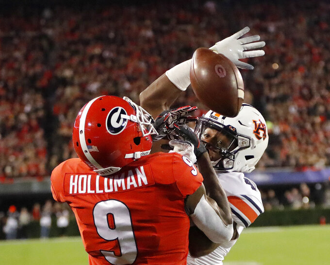 Auburn defensive back Noah Igbinoghene breaks up a pass intended for Georgia wide receiver Jeremiah Holloman (9) during the first half of an NCAA college football game Saturday, Nov. 10, 2018, in Athens, Ga. (AP Photo/John Bazemore)