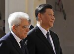 Chinese President Xi Jinping, right, and Italian President Sergio Mattarella review the honor guard at the Quirinale Presidential Palace, in Rome, Friday, March 22, 2019. Jinping is launching a two-day official visit aimed at deepening economic and cultural ties with Italy through an ambitious infrastructure building program called