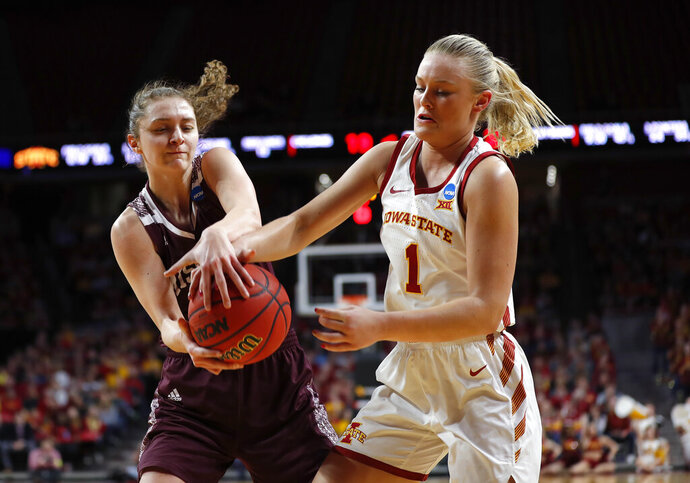 Missouri State guard Alexa Willard, left, steals the ball from Iowa State forward Madison Wise during the first half of a second-round women's college basketball game in the NCAA Tournament, Monday, March 25, 2019, in Ames, Iowa. (AP Photo/Matthew Putney)