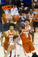 Texas guard Courtney Ramey (3) drives the ball to the basket for the winning score in the second half of an NCAA college basketball game against Davidson in the Maui Invitational tournament, Monday, Nov. 30, 2020 in Asheville, N.C. Texas won 78-76. (AP Photo/Kathy Kmonicek)