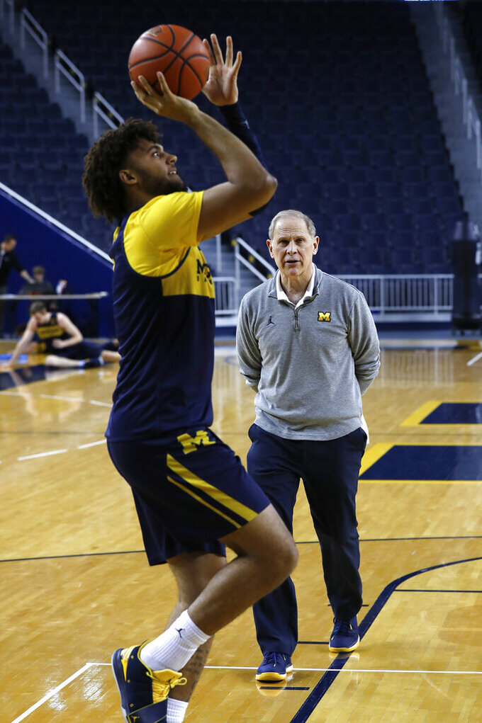 Michigan head basketball coach John Beilein watches Isaiah Livers shoot during practice in Ann Arbor, Mich., Tuesday, Feb. 19, 2019. Beilein and Michigan State's Tom Izzo are friendly rivals, whose highly ranked NCAA college basketball teams will play for the first time this season on Sunday at Crisler Arena. As much as Beilein and Izzo genuinely like and respect each other, the highly competitive coaches want to win. (AP Photo/Paul Sancya)