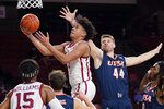 Oklahoma forward Jalen Hill (1) goes to the basket in front of UTSA forward Luka Barisic (44) during the first half of an NCAA college basketball game Thursday, Dec. 3, 2020, in Norman, Okla. (AP Photo/Sue Ogrocki)