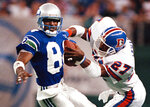 FILE - In this Oct. 23, 1989, file photo, Seattle Seahawks' Louis Clark (84) brings in a pass as Denver Broncos' Steve Atwater defends during an NFL football game in Seattle. Atwater will be inducted into the Pro Football Hall of Fame with the class of 2020. (AP Photo/Barry Sweet, File)