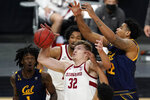 Stanford's Lukas Kisunas (32) and California's Andre Kelly (22) vie for a rebound during the first half of an NCAA college basketball game in the first round of the Pac-12 men's tournament Wednesday, March 10, 2021, in Las Vegas. (AP Photo/John Locher)
