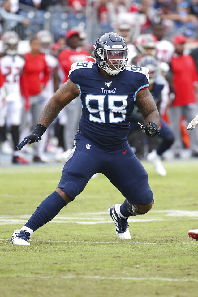 FILE - In this Oct.27, 2019, file photo, Tennessee Titans defensive tackle Jeffery Simmons (98) plays during an NFL football game against the Tampa Bay Buccaneers in Nashville, Tenn. Simmons, DaQuan Jones and Harold Landry are ready for the challenge of  filling the hole left by Tennessee trading five-time Pro Bowl defensive lineman Jurrell Casey to Denver in March. (AP Photo/Michael Zito, File)