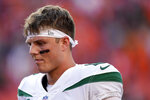 New York Jets quarterback Zach Wilson leaves the field after an NFL football game against the Denver Broncos , Sunday, Sept. 26, 2021, in Denver. The Broncos won 26-0. (AP Photo/David Zalubowski)