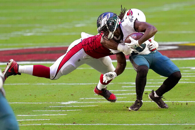Arizona Cardinals linebacker Marcus Golden sacks Philadelphia Eagles quarterback Jalen Hurts, right, during the first half of an NFL football game, Sunday, Dec. 20, 2020, in Glendale, Ariz. (AP Photo/Ross D. Franklin)