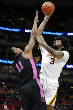 Minnesota's Jordan Murphy (3) shoots over Penn State's Lamar Stevens (11) during the first half of an NCAA college basketball game in the second round of the Big Ten Conference tournament, Thursday, March 14, 2019, in Chicago. (AP Photo/Kiichiro Sato)