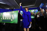 Democratic presidential candidate Sen. Amy Klobuchar, D-Minn., acknowledges applause at her election night party, Tuesday, Feb. 11, 2020, in Concord, N.H. (AP Photo/Robert F. Bukaty)