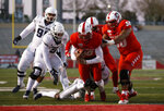 New Mexico quarterback Trae Hall (10) reaches the end zone for a touchdown defended by Utah State safety Troy Lefeged (3) during the second half of an NCAA college football game on Saturday, Nov. 30, 2019 in Albuquerque, N.M. (AP Photo/Andres Leighton)
