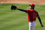Los Angeles Angels pitcher Shohei Ohtani catches a ball during an intrasquad game at baseball practice at Angel Stadium on Tuesday, July 7, 2020, in Anaheim, Calif. (AP Photo/Ashley Landis)