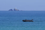 A security boat patrols off the coast of Carbis Bay, England, Saturday, June 12, 2021, as the G-7 summit takes place. (AP Photo/Patrick Semansky)