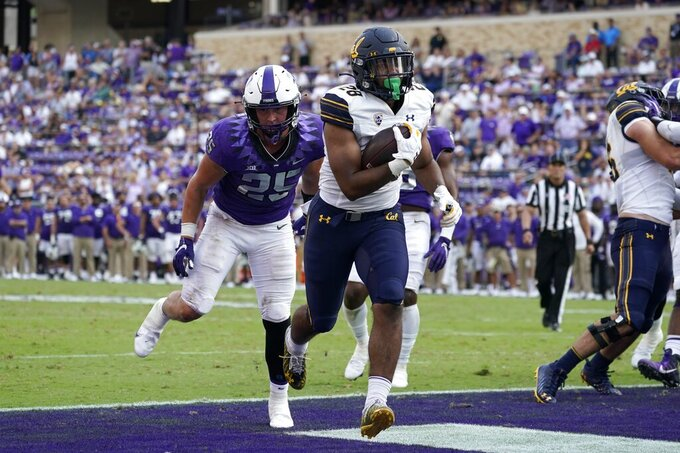 California running back Damien Moore (28) gets past TCU linebacker Wyatt Harris (25) to score a touchdown on a running play in the second half of an NCAA college football game in Fort Worth, Texas, Saturday, Sept. 11, 2021. (AP Photo/Tony Gutierrez)
