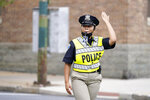 In this Sept. 9, 2020, photo Cierra Thurmond, a cadet in the Baltimore Police Academy, directs traffic during an on the field class session in Baltimore. (AP Photo/Julio Cortez)