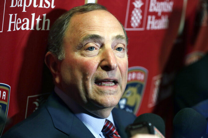 FILE - In this March 7, 2020, file photo, National Hockey League Commissioner Gary Bettman speaks to members of the media in Sunrise, Fla. Bettman says time is running out to reach a deal to send players to the 2022 Winter Olympics in Beijing. The league, players, International Olympic Committee and International Ice Hockey Federation continue negotiations. (AP Photo/Wilfredo Lee, File)