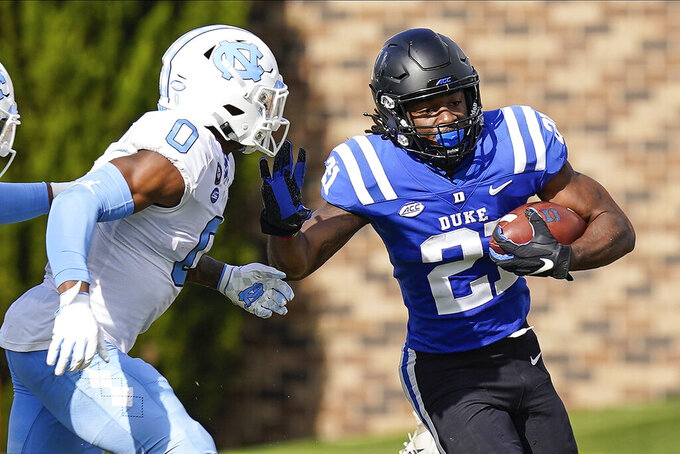 North Carolina defensive back Ja'Qurious Conley (0) chases Duke running back Mataeo Durant (21) during the first half of an NCAA college football game at Wallace Wade Stadium, Saturday, Nov. 7, 2020, in Durham, N.C. (Jim Dedmon/Pool Photo via AP)
