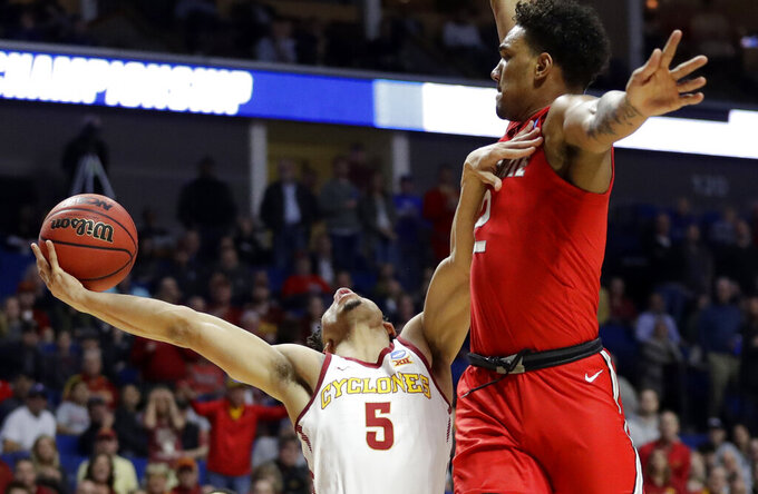 Iowa State's Lindell Wigginton (5) throws up a shot as Ohio State's Musa Jallow defends during the first half of a first round men's college basketball game in the NCAA Tournament Friday, March 22, 2019, in Tulsa, Okla. (AP Photo/Jeff Roberson)