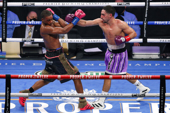 Errol Spence Jr. steps back from a punch thrown by Danny Garcia during the WBC IBF welterweight championship boxing bout in Arlington, Texas, Saturday, Dec. 5, 2020. (AP Photo/Brandon Wade)