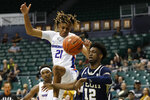 Boise State guard Derrick Alston (21) and Georgia Tech forward Khalid Moore (12) fight for a loose ball during the second half of an NCAA college basketball game Sunday, Dec. 22, 2019, in Honolulu. (AP Photo/Marco Garcia)