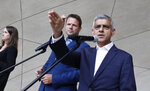 FILE - In this Sept. 2, 2019 file photo London Mayor Sadiq Khan, right, speaks at a news conference alongside Warsaw Mayor Rafal Trzaskowski in Warsaw, Poland. A pro-European liberal, Trzaskowski, has recently joined the race for the nation's president and has emerged as the main challenger to incumbent President Andrzej Duda who had previously seemed certain to win. The date of the vote is yet to be announced.(AP Photo/Czarek Sokolowski)