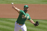 Oakland Athletics' James Kaprielian pitches against the Texas Rangers during the first inning of a baseball game in Oakland, Calif., Sunday, Sept. 12, 2021. (AP Photo/Jeff Chiu)