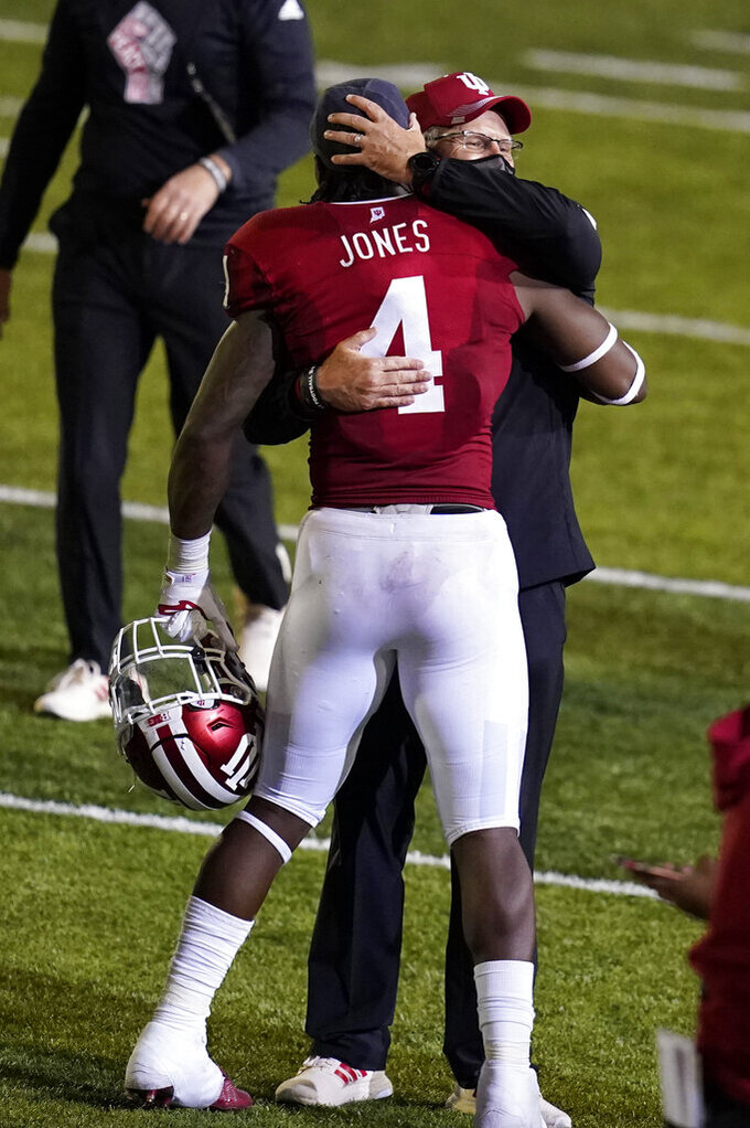 Indiana head coach Tom Allen and Cam Jones (4) celebrate after Indiana defeated Penn State in overtime of an NCAA college football game, Saturday, Oct. 24, 2020, in Bloomington, Ind. Indiana won 36-35 in overtime. (AP Photo/Darron Cummings)
