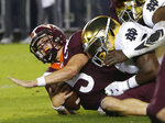 Virginia Tech quarterback Ryan Willis (5) is slammed to the ground on third down near the goal line during the first half of an NCAA college football game in Blacksburg, Va., Saturday, Oct. 6, 2018. (AP Photo/Steve Helber)