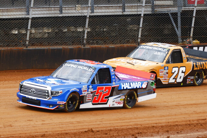 Driver Stewart Friesen (52) leads Tyler Ankrum (26) during prerace laps as they compete in a heat race for a NASCAR Truck Series race on Saturday, March 27, 2021, in Bristol, Tenn. (AP Photo/Wade Payne)