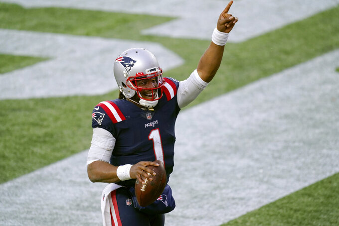 New England Patriots quarterback Cam Newton celebrates his touchdown catch of a pass thrown by wide receiver Jakobi Meyers during the second half of an NFL football game against the New York Jets, Sunday, Jan. 3, 2021, in Foxborough, Mass. (AP Photo/Elise Amendola)