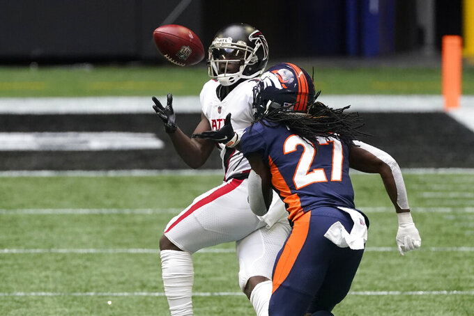 Atlanta Falcons wide receiver Olamide Zaccheaus (17) makes the catch against Denver Broncos cornerback Horace Richardson (27) during the first half of an NFL football game, Sunday, Nov. 8, 2020, in Atlanta. (AP Photo/John Bazemore)