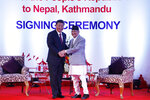 Chinese President Xi Jinping, left, and Nepalese Prime Minister Khadga Prasad Oli greet during their bilateral meeting in Kathmandu, Nepal, Sunday, Oct. 13, 2019. Xi on Saturday became the first Chinese president in more than two decades to visit Nepal, where he's expected to sign agreements on some infrastructure projects. (Bikash Dware/The Rising Nepal via AP)