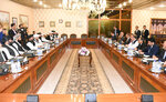 In this photo released by the Foreign Office, Pakistan's Foreign Minister Shah Mehmood Qureshi, fourth from right, heads talks with Taliban delegation at the Foreign Office in Islamabad, Pakistan, Thursday, Oct. 3, 2019. Senior Taliban leaders are meeting with Qureshi in Islamabad as part of a push to revive an Afghanistan peace deal that has included stops in Russia, China and Iran. (Pakistan Foreign Office via AP)