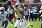 Georgia Tech quarterback Tobias Oliver (8) runs into the end zone for a touchdown during the second half of an NCAA college football game against the Citadel, Saturday, Sept. 14, 2019, in Atlanta. The touchdown was denied as Georgia Tech head coach Geoff Collins had called for a time out. The Citadel won 27-24 in overtime. (AP Photo/Mike Stewart)