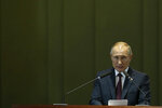 Russia's President Vladimir Putin speaks during the Leaders Dialogue with BRICS Business Council and the New Development Bank, at the Itamaraty Palace in Brasilia, Brazil, Thursday, Nov. 14, 2019. (AP Photo /Eraldo Peres)